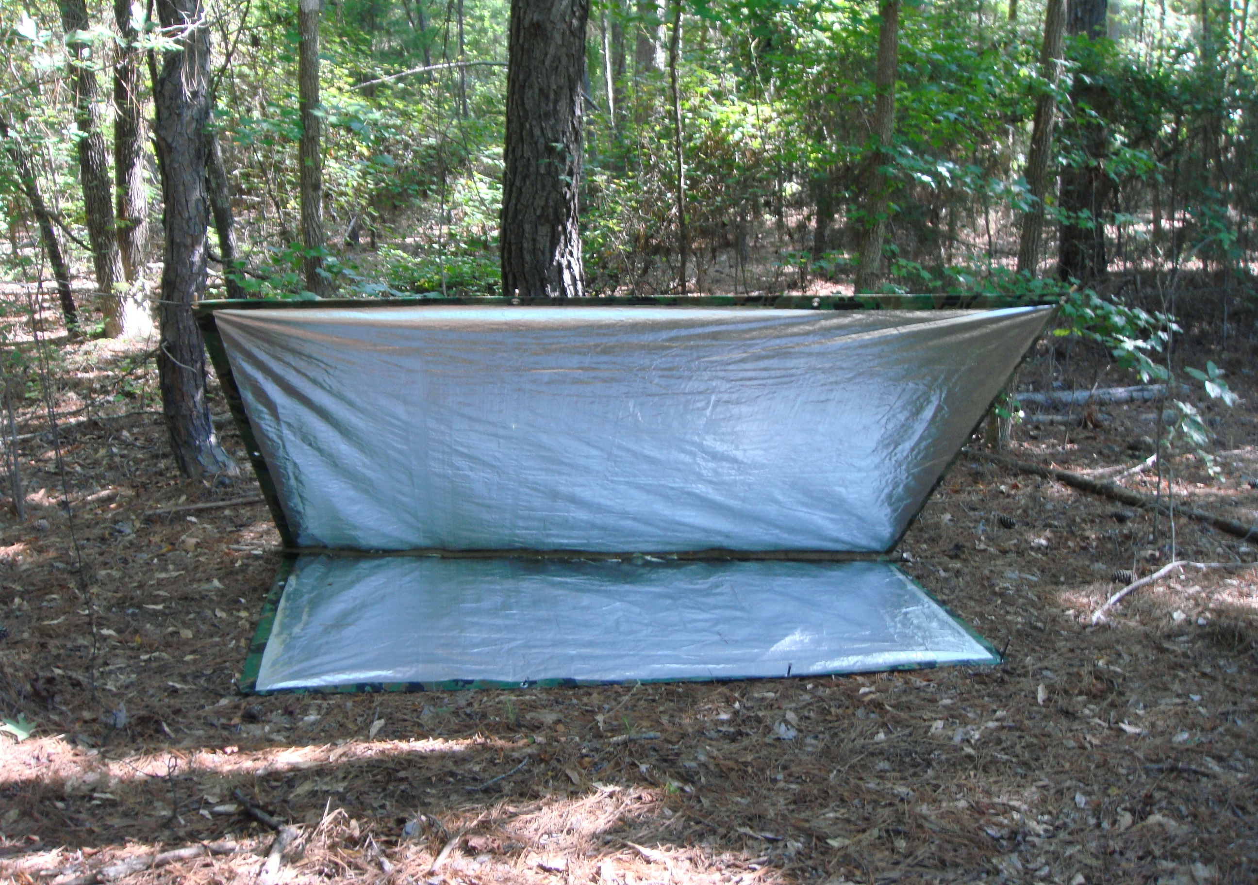 This is not really a new idea. I can recall Mors Kochanski advocating for this quite a few years ago when he developed his concept of the u201csuper shelter. & Make an Inexpensive Reflector Tarp for a Warm Survival Shelter ...